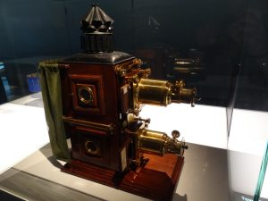 "A ""magic lantern"" projector that would project two images simultaneously: one static, and one with moving elements."